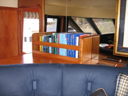 bookshelf island behind a couch yacht furniture