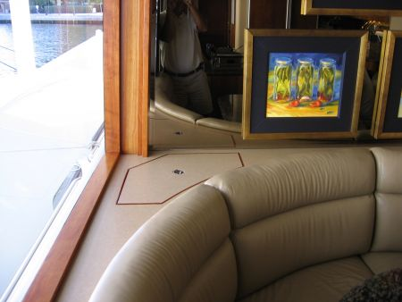 hidden compartment behind a couch on a yacht