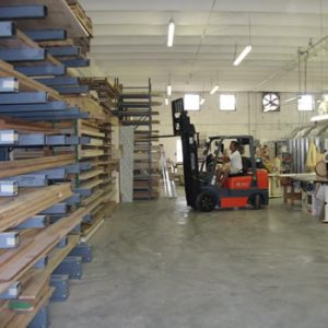 selecting wood panels from our shop at Dennis boatworks forklift operator in Fort Lauderdale