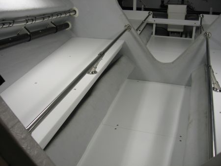 Photo of shelving customized for optimal storage below deck designed with Dennis Boatworks.