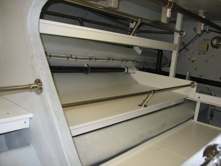 Image of below deck storage shelves customized by Dennis Boatworks.