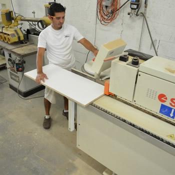 wood paneling feeding wood into a cutting machine