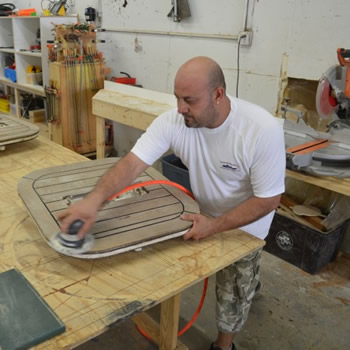 wood sanding by Dennis Boatworks