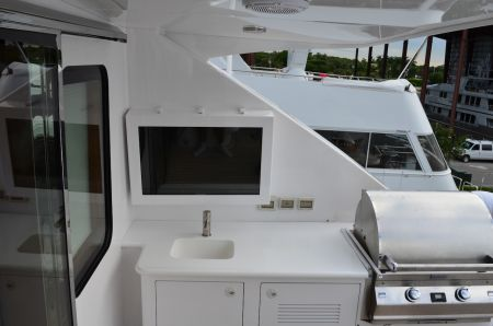 An image of all white furnishings on an outdoor deck planned by Dennis Boatworks.