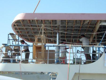 Image of master craftsmen in progress of completing a custom structural design by Dennis Boatworks.