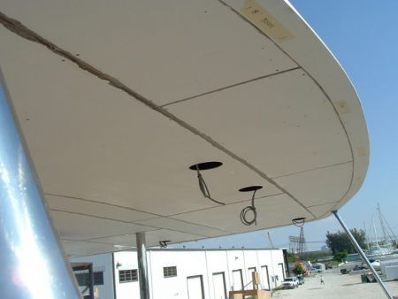 Image of custom light fixtures being installed on a yacht by Dennis Boatworks.