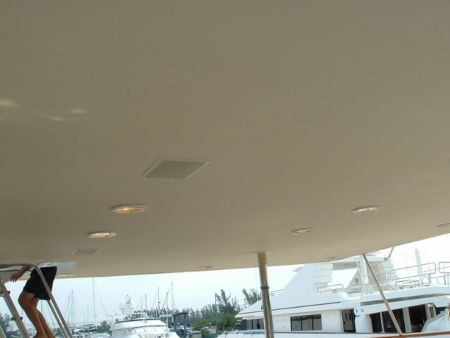 Image of light fixtures on the ceiling of a deck on the yacht highlight the custom structural design abilities of Dennis Boatworks.