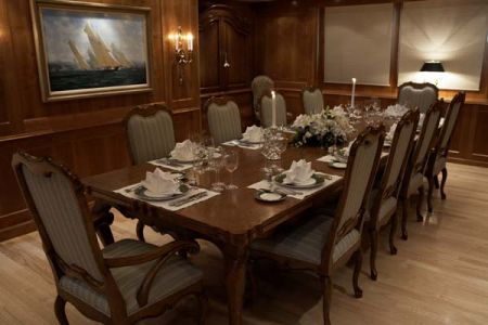dinner table with sailing art on the wall 10 person table on a yacht