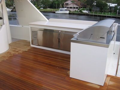 Image of a custom wine storage cooler on the outside deck of a yacht.