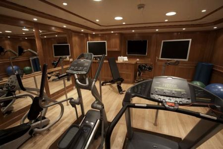 gym treadmills three televisions and weight set on a yacht - flooring by Dennis Boatworks Ft. Lauderdale marine carpenter