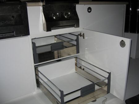 Image of two custom drawers that slide out of the cabinet with the cabinet door open.