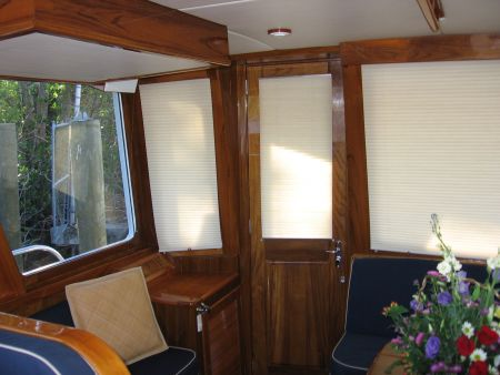 Image of custom wood interior by Dennis Boatworks.