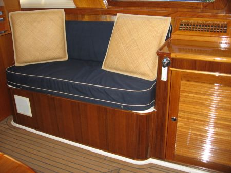 side view sitting area yacht entrance foyer furniture custom made and installed by Dennis Boatworks