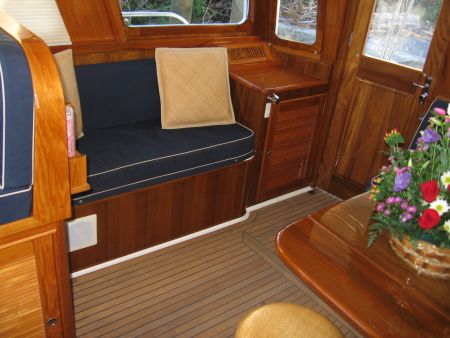 sitting area yacht entrance foyer furniture custom made and installed by Dennis Boatworks