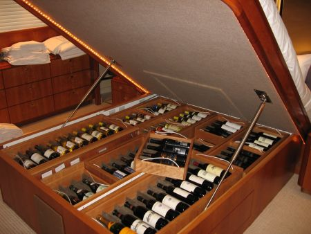 under the bed wine rack custom made carpentry hidden compartment by Dennis Boatworks