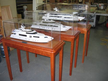 Image of model yachets on display in custom wood and acrylic cases made by Dennis Boatworks.