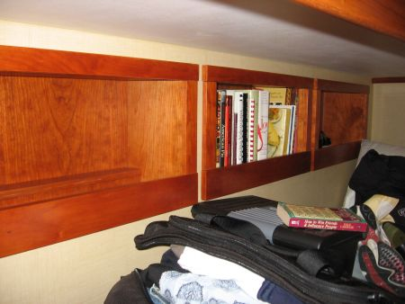 Bookshelves on a yacht custom install by bed