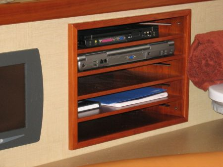 Entertainment set for TV remote, VCR, and DVD player shelving for a yacht
