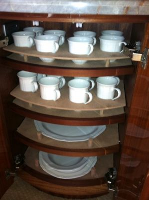 Photo of custom acrylic shelving for protective porcelain glass dish storage by Dennis Boatworks.