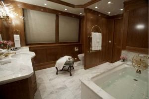 marble master bathroom elegant high class shiny sparkling well lit yacht
