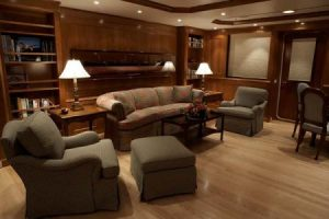 Couch sitting area on a superyacht - Custom Yacht Workworking and Custom Teak Flooring - further away