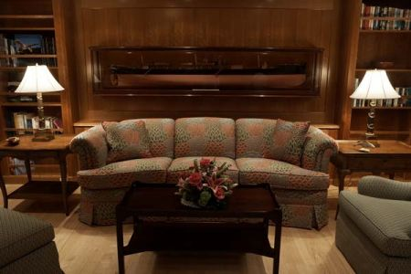 Couch sitting area on a superyacht - Custom Yacht Workworking and Custom Teak Flooring - close up