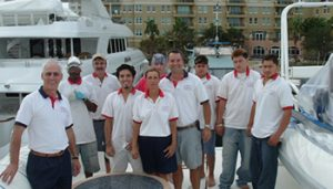 A staff photo of 10 people who all work for Dennis Boatworks.