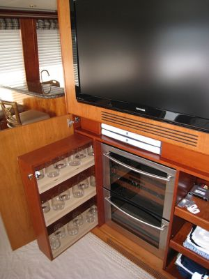 suede shelving and entertainment system custom built for the Dona Lola by Dennis Boatworks