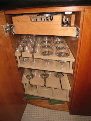 wine and champagne bar storage suede custom made shelving by Dennis Boatworks a custom yacht carpenter in Fort Lauderdale Florida