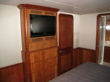 bedroom entertainment set attached to a bedroom on a yacht - woodworking by Dennis Boatworks