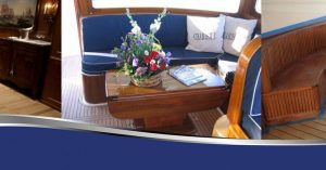 A banner of three images of different dining tables: a 10-person table, a small deck table, and a circular booth table from Dennis Boatworks. Why-Choosing-Your-Yacht-Materials-is-Important