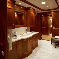 beautiful modern classical shiny bathroom on a yacht custom drawers and storage and lockers lavatory towel rack light well lit loo