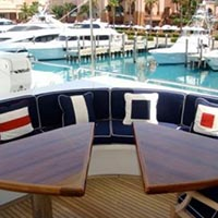 triangle tables and couch on back of yacht in a marina custom designed