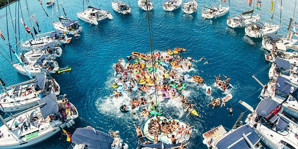 circle of boats together people in the water celebrating enjoying