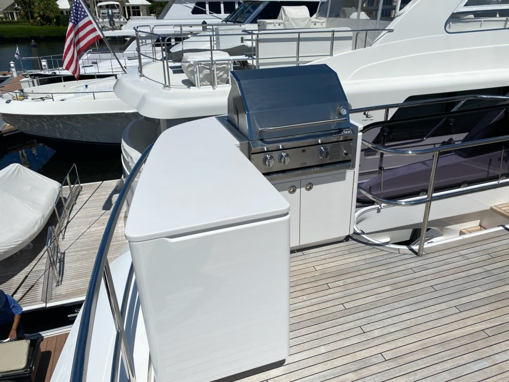 custom teak deck boat yacht BBQ pit American flag in the background